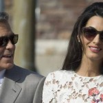 George Clooney and Amal Alamuddin leave the Aman hotel in Venice on Sunday, Sept. 28. (Andrew Medichini/AP)