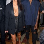 KIM KARDASHIAN & KANYE WEST Kim and Kanye make a bold fashion statement front row at the Lanvin show. Dominique Charriau/WireImage
