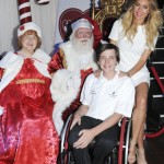 Santa Claus and Mrs. Claus with a respresentative from Shriners Hospital and Jasmine Dustin (Photo: WireImage)