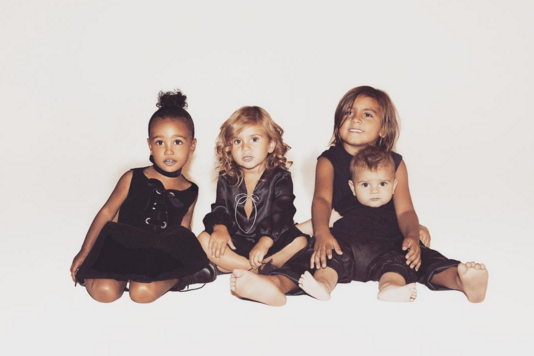 Kim Kardashian posted this adorable Christmas card of her daughter North and sister Kourtney's brood of Mason, Penelope and Reign. (Photo: Instagram, @kimkardashian)