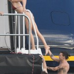 As a bikini-clad Kendall decided she'd had enough of the water for one day, she was grabbed unexpectedly by a playful Harry when he decided he didn't want the fun to end and latched onto one of her long limbs, which were hard to miss in a teeny leopard print bikini. (Photo: Golfphotos)