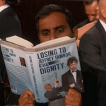 BEST: Aziz Ansari's nomination shot showed him reading a prop book titled Losing to Jeffrey Tambor with Dignity. A pretty hilarious preparation for failure. (Photo: Instagram, @parksandoffice30)