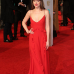 Dakota Johnson looked stunning in a red silk Dior dress, but she couldn't bag an award for either of her two nominations. (Photo: Instagram, @dior)