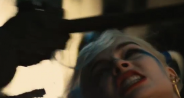 Margot Robbie took a baseball bat to the face