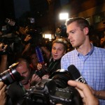 US swimmers Gunnar Bentz and Jack Conger leave the Delegacia de Turismo do Leblon after police questioned them in Rio de Janeiro on Thursday. (Photo: AgNews)