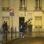 A handcuffed man was seen being led in to a police station in Paris following the raids this week (Photo: VantageNews)