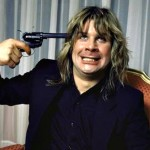 Ozzy Osbourne clowns with a prop gun in the early 80's. (Photo: Archive)