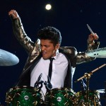 #11 - Bruno Mars' first appearance in 2014 began with an incredible drum solo while surfing through the crowd on a platform. (Photo: Twitter)
