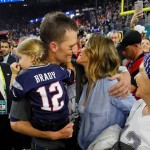 Tom and wife Giselle celebrate w/ family after the big win. (Photo: Twitter)