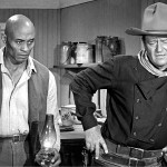"NFL African-American trailblazer Woody Strode with John Wayne in ""The Man Who Shot Liberty Valance."" (Photo: Archive)"