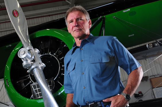 Harrison Ford poses with his aircraft. (Photo: Wikimedia)