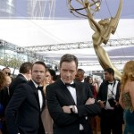 Aaron Paul steals Bryan Cranston's photo-op at the 2013 Emmys. (Photo: Archive)