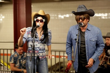 An Undercover Miley Cyrus Gives Subway Performance In Disguise