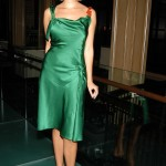 Back to a more sophisticated style with this jewel toned dress. (Photo: Archive)