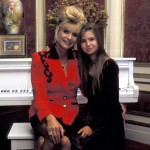 Another velvet dress, this time black, for a picture with her mom. (Photo: Archive)