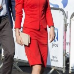 In a bright red Armani skirt suit. (Photo: Archive)