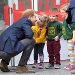 Prince Harry getting an adorable kiss from a young fan. (Photo: Archive)