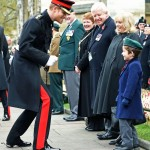Prince Harry goofing around with a kid while he visited the Field of Remembrance. (Photo: Archive)
