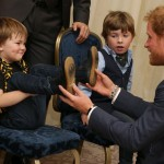 Prince Harry bonding with a little boy when he attended the Well Child Awards. (Photo: Archive)