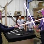 Prince Harry and Prince William dueling each other with lightsabers while visiting the Star Wards set. (Photo: Archive)