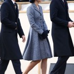 In a Michael Kors coat dress with black gloves, and a brimmed hat. (Photo: Archive)