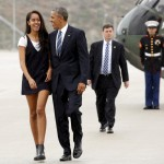 Obama and Malia walking in the rain from Marine One to board Air Force One. (Photo: Archive)