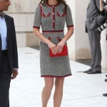 In a Gucci tweed dress, red clutch and black heels. (Photo: Archive)
