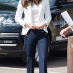 In J. Crew kick flare pants, a Zara white blazer, a matching t-shirt, and a neutral wedge. (Photo: Archive)