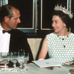Queen Elizabeth II and Prince Philip smiling at each other at a state banquet in 1970. (Photo: Archive)