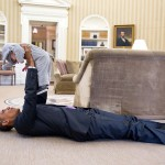 Obama plays with Ella Rhodes, the daughter of his deputy national security adviser, in the Oval Office. (Photo: Archive)