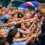 President Obama greets the children of US embassy staff. (Photo: Archive)
