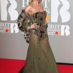 Rita Ora in a camo dress for the Brit Awards 2017 in London. (Photo: WENN)