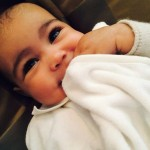 Kim waxes North's eyebrows. (Photo: Instagram)
