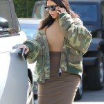 Kim Kardashian talking on the phone as she leaves Epion Skin Clinic in Beverly Hills. (Photo: WENN)