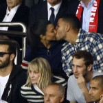 The pair kissed during a Paris Saint-Germain F.C. match (Younes' favorite soccer team) and he kept his eyes open and on the field. (Photo: WENN)