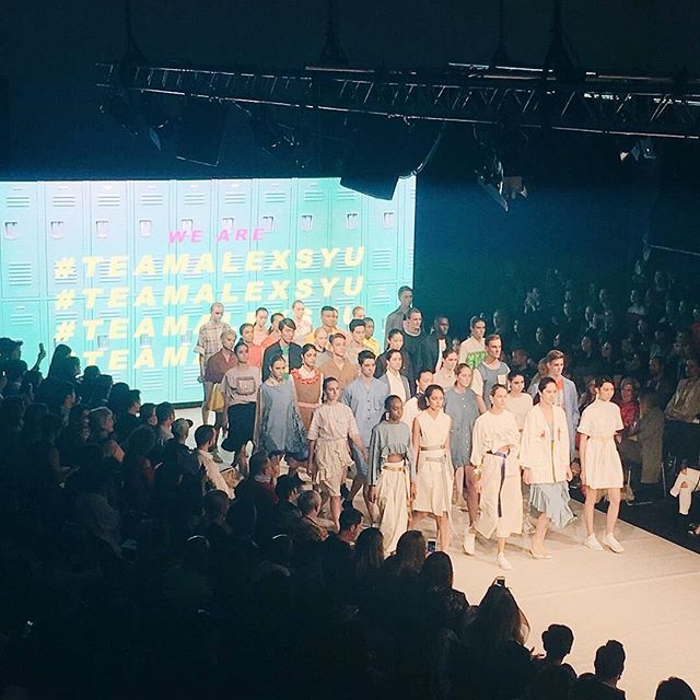 Alex S Yus unisex collection was presented in front of a digital screen featuring green school lockers. (Photo: Instagram)