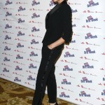 "Victoria Beckham wearing a sleek black suit for the BritWeek 2010 charity event ""Save The Children And Virgin Unite"". (Photo: WENN)"