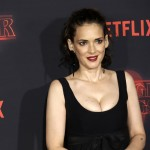 Joyce Byers left her baggy clothes and home to rock this low cut black dress at the premiere. (Photo: WENN)