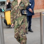 April 19—Arriving to London in a camo jumpsuit, black conductor hat, and black leather boots. (Photo: WENN)