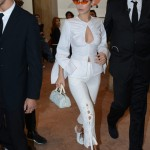 September 19—Wearing a white cut out top with lace up pants, a small white handbag, orange see-through sunglasses, and lace-up heels while out in Milan. (Photo: WENN)