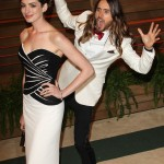 Here he is, doing it again, photobombing Anne Hathaway. I mean, that's what anyone would do right after winning an Oscar! (Photo: WENN)