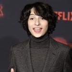 Finn walked away from his Stranger Things bowl haircut, and let his natural curls go free for the season 2 premiere! (Photo: WENN)