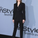 Dakota Johnson wearing a sharp black suit at the 2015 InStyle Awards. (Photo: WENN)