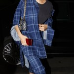 July 2—In plaid navy flannel trench and matching pants by Marcelo Burlon County of Milan, balack crop top, Dior bag, and pointed SCHUTZ mules. (Photo: WENN)
