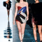 Jenner modeling an embellished strapless mini dress, featuring a red, blue and silver graphic design by Alexandre Vauthier. (Photo: WENN)