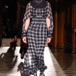 Kendall Jenner rocking a long plaid dress paired with matching plaid tights and shoes, completed with an embellished collar and matching plaid belt. (Photo: WENN)