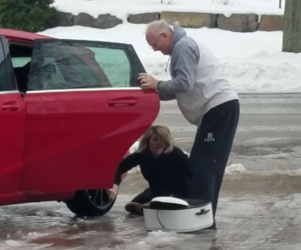 Suzzane Charter couldn't get into her car—even when she gripped to her dad for support! (Photo: YouTube)