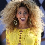 Beyoncé rocking her big hair at a 2011 concert in Central Park. (Photo: WENN)