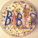 "The future mother of four shared a picture of the colorful cake with the word ""BABY?"" written in pink and blue frosting. (Photo: Instagram)"