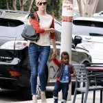 "Charlize Theron adopted a baby boy, Jackson, in secret in March 2012 and a baby girl, August, in 2015. ""I now travel in a pack,"" the actress joked. (Photo: WENN)"